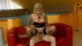 Mature blonde whore Effie with big fake tits and bouncing